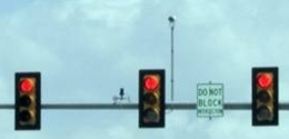 Traffic Sensor (left of center traffic signal) and Traffic Camera (right of center traffic signal).